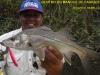 O pescador e seu troféu